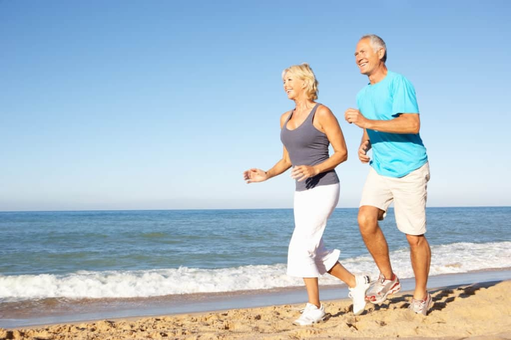 People jogging on beach without glasses after cataract surgery Gold Coast